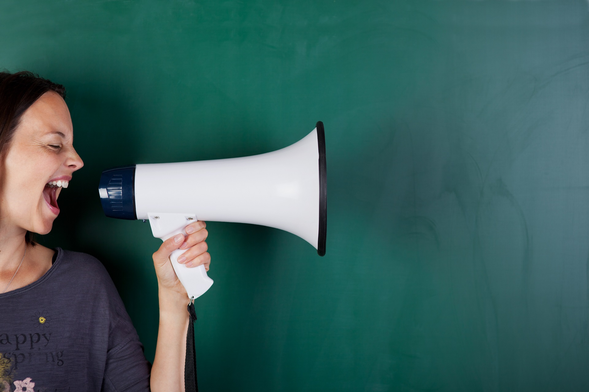 A woman yelling into a megaphone